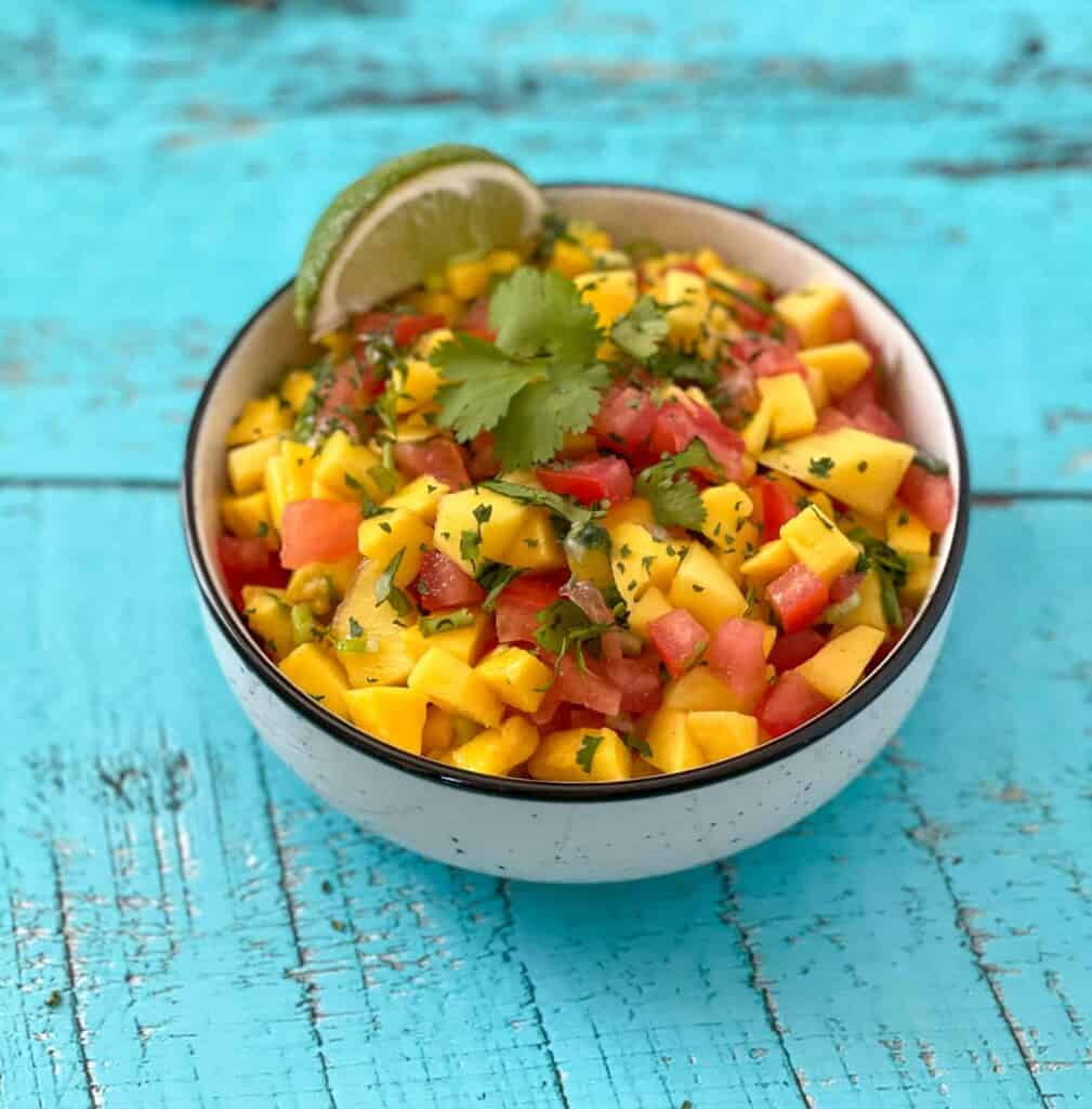 Mango, lime and cilantro salsa in a bowl