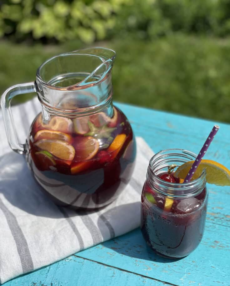 Red wine sangria and a glass filled with fruits and sangria