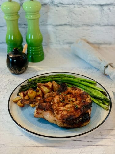 Grilled pork chops marinated in Dijon mustard and Provence herbs
